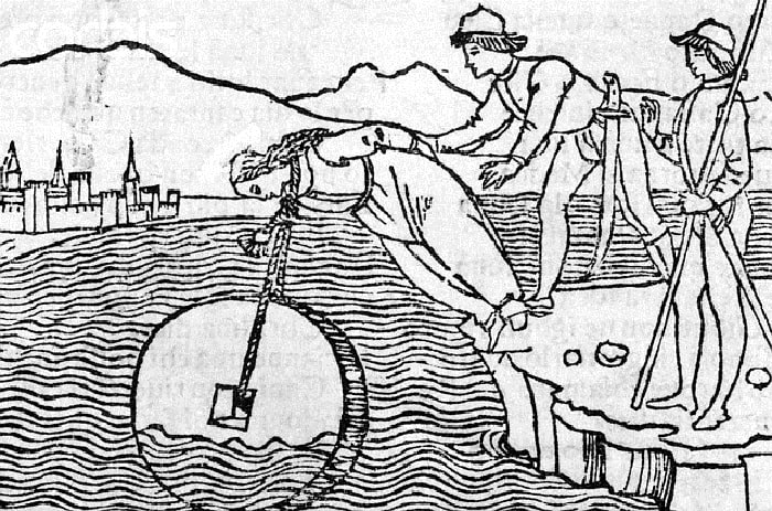 Original caption: Drowning a woman with a millstone around her neck. 1554 --- Image by © Corbis